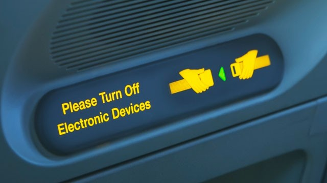 gty_airplane_sign_please_turn_off_electrical_devices-thg_130621_wg