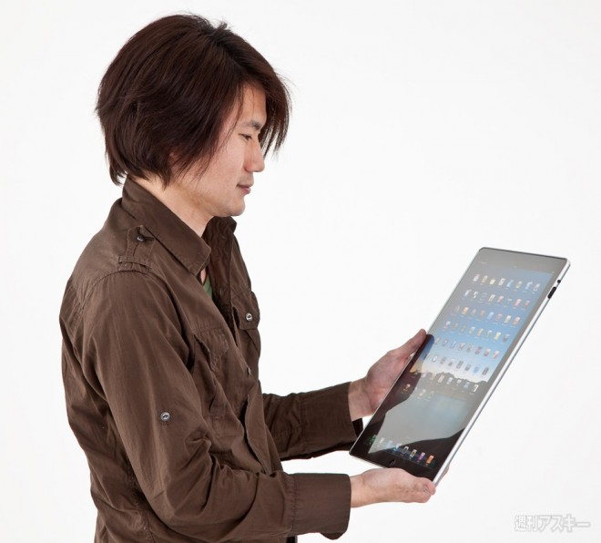 iPad-L-held-in-hands-profile
